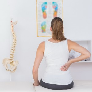 Wear view of patient with back pain in medical office